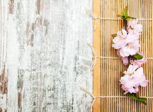 Sakura branch on a bamboo mat Stock Photo