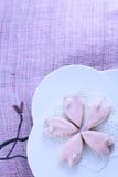 Sakura cookies. Sakura shaped cookies on a white plate Stock Photo