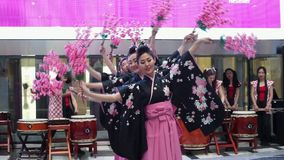 Sakura dance. Moscow, Russia - March 24, 2017: group of japanese geishas in traditional japanese kimono dancing in a mall Riviera. The performance dedicated to stock video footage