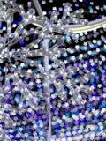 Sakura deu forma ao bokeh de decorar luzes durante o Natal e o festival do ano novo Imagem de Stock