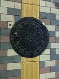 Sakura. Manhole cover in Tokyo ,Japan Royalty Free Stock Photos