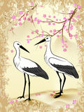 Sakura and stork. Two storks, looking at each other, against the background of branches and flowers Sakura and mountain landscape, painted in Japanese style in Stock Photos