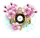 Sakura watch on white background. Antique, gold watch with sakura flowers on white background. Spring Festival. Sakura blossoms.  Hanami Stock Photos