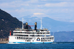 Sakurajima Ferry crosses Kinko Bay Royalty Free Stock Photo