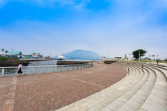 Sakurajima, Kagoshima waterfront. KAGOSHIMA,JAPAN - 19 JUNE,2017: Sakurajima is an active composite volcano and a former island . however the city provide the Royalty Free Stock Image