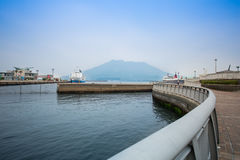 Sakurajima, Kagoshima waterfront. KAGOSHIMA,JAPAN - 19 JUNE,2017: Sakurajima is an active composite volcano and a former island . however the city provide the Royalty Free Stock Photos