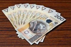 Salário do dinheiro no Polônia Fotografia de Stock