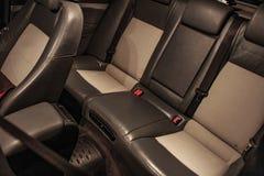 Salão de beleza de um carro, partes do couro e plástico fotografia de stock royalty free