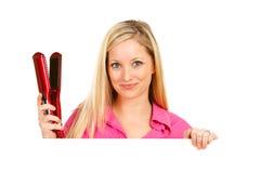 Salón: Peluquero Holds Hair Straightener Imágenes de archivo libres de regalías
