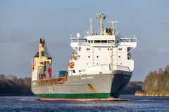 SAL heavy lift ship ANNE-SOFIE in the Kiel Canal. SAL Heavy Lift is one of the world's leading carriers specialised in sea transport of heavy lift and royalty free stock images