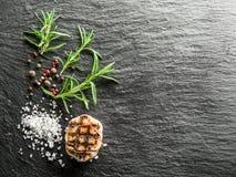 Sal, romero y granos de pimienta Imagen de archivo libre de regalías