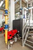 Sala de caldeira interior do gás com uma caldeira de gás e um queimador de gás Fotografia de Stock Royalty Free