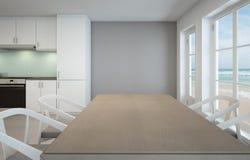 Sala de jantar e cozinha da opinião do mar na casa de praia luxuosa Imagem de Stock