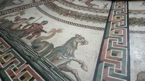 Sala Rotonda in Vatican Museum. Sala Rotonda in Museo Pio Clementino of Vatican Museum with mosaic picture on floor and tourists around big plate on four legs stock video