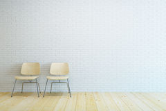 Sala vazia com a cadeira dois e a parede de tijolo branca Fotos de Stock Royalty Free