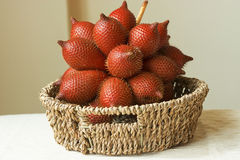 Salacca on the basket,Salacca is a genus of about 20 species of palms native to Southeast Asia and the eastern Himalayas. Salacca on the basket,Salacca is stock photo
