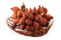 Salacca or zalacca tropical fruit in basket Royalty Free Stock Photography