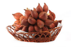 Salacca or zalacca tropical fruit in basket Royalty Free Stock Photo