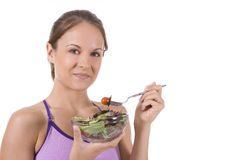 Salad. Young woman on white background with a salad Stock Photo