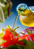 Salad. Virgin olive oil pouring over tomato salad Royalty Free Stock Photo