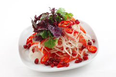 Salad. With pomegranates and red pepper in a white cup on a white background royalty free stock images