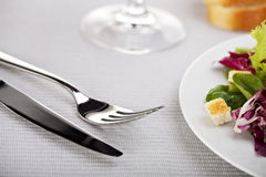 Salad. Mixed salad, a fork and a knife Royalty Free Stock Images