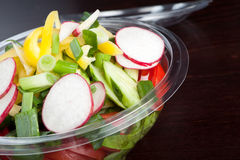 Salad. Green salad from cucumber, tomatoes, letuce, radish and green onion Royalty Free Stock Images