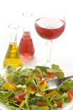 Salad. Fresh colorful salad close up on the table with oil and winegar Royalty Free Stock Photo