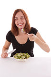 Salad. A young woman eating a salad Royalty Free Stock Photo