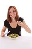 Salad. A young woman eating a salad royalty free stock photo