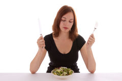 Salad. A young woman eating a salad Stock Photos
