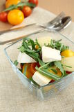 Salad. With green leaves and vegetables in a transparent cup Royalty Free Stock Image