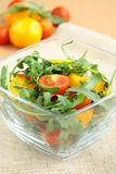 Salad. With green leaves and vegetables in a transparent cup stock image