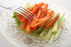 Salad. Celery and carrot salad over white background Stock Images