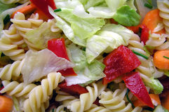 Salad. Mixed salad with pasta and vegetables stock photo