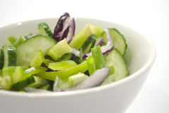 Salad. From vegetables in a white plate, it is isolated on white Stock Photos