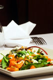 Salad. Braised greens squash goat cheese and pumpkin seeds in a fine dining restaurant royalty free stock image