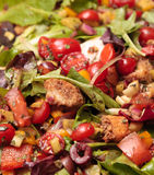 Salad. Fresh green garden salad with lettuce, tomatos, bread crumbs, peppers Stock Photo