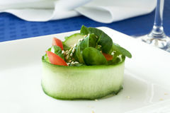 Salad. Green salad on white plate Royalty Free Stock Photos