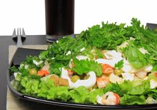 Salad. With shrimps, dried crust, leaf of lettuce and fizz drink. isolated Stock Image