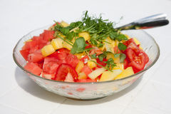 Salad. On the white table Royalty Free Stock Photography