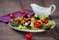 Salad. Fresh garden salad with a fork Royalty Free Stock Photos