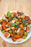 Salad. Fresh salad on a plate with figs and squash stock photos