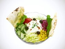 Salad. With fresh leaves, tomato, cucumber, cream, olives, corn and pepper Royalty Free Stock Photo