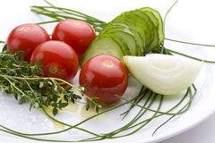Salad. Fresh salad ingredients on a white plate Royalty Free Stock Image