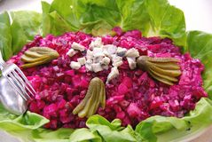 Salad. A herring with beetroot salad finished with gerkins Royalty Free Stock Image
