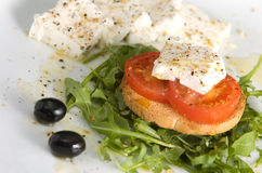 Salad. Cottage cheese salad with rocket and tomato Stock Photo