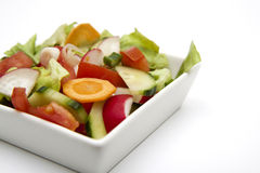 Salad. Fresh sprin vegetables in a white plate Stock Images