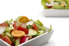 Salad. Fresh sprin vegetables in a white plate Stock Photo