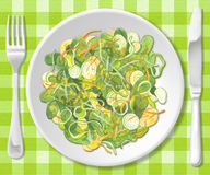Salad. Mixed salad with onions and carrots with knife and fork Royalty Free Stock Images